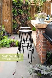 rustic outdoor kitchen bar with stools