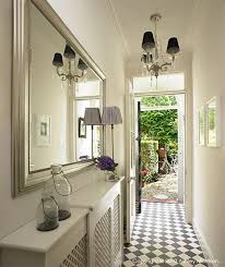 decorate narrow entryway hallway entrance. Decoration,Narrow Hallway Lighting Ideas With Beautiful Chandelier And Wall Mounted Wide Mirror Featuring White Paint Combine Geometric Flooring Decorate Narrow Entryway Entrance