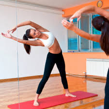 benefits of using gym mirrors in home