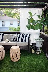 the beverly sectional from hampton bay on a beautifully decorated backyard deck with an artificial grass