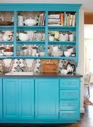 love the artsy colorful colored look makes me want to paint my cabinets bright painted furniture