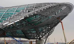 The roof structure of the 244m aquatic centre, designed by Zaha Hadid. The  roof will now be covered by aluminium. Photograph: Kirsty Wigglesworth/AP  ...