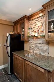 wet bar with stone column and glass shelves jackolanternliquors rustic kitchen bar ideas