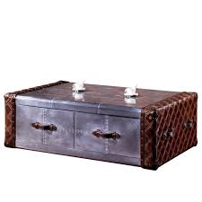 this leather aluminum mixed trunk coffee table present with famed european antiques its careful construction and handsome detailing marked it as tailored