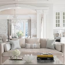 light wood coffee table. Gray Skirted Sofa With Silver Metallic Pillows Light Wood Coffee Table D