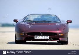 Car, Jaguar XJ 220, model year 1994, wine-red-metallic, coupe ...