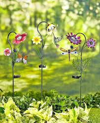 solar flower garden lights add beautiful lighted decor to your yard these stained glass solar flower garden stakes the