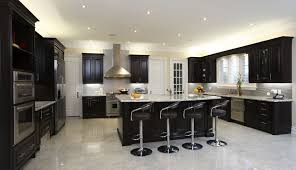 black and stainless kitchen spacious modern kitchen with dark cabinetry breakfast bar  modern diner style stools and