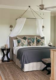small white guest room with white and dark blue bedding sets