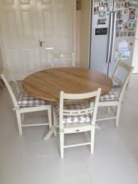 neptune dining table and 4 chairs