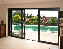 large double sliding patio door with black frame facing garden pool fabulous double sliding patio
