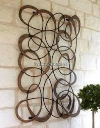 brown large horchow outdoor mingling circles outdoor metal art for wall decor plaque patio garden hang on green and brown metal wall art with wall art lastest images outdoor metal art for walls patio wall
