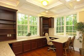 home office built ins. downstairs home office with coffer ceiling. built ins