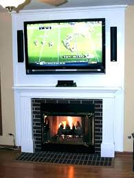 hanging tv above fireplace hanging over fireplace hang how
