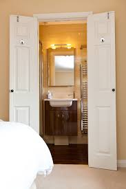 Wooden bifold bathroom doors for small spaces with 2 panel
