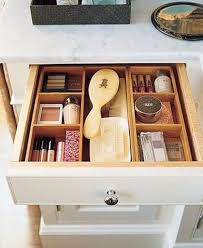Wooden drawer dividers for makeup.