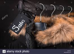 Coat Rack Black Friday A lot of black coats jacket with fur on hood hanging on clothes 53