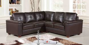 living room black leather sofa with short brown wooden legs placed on the white rug