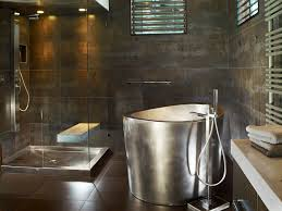 stainless steel japanese soaking tub with matching stainless steel shower pan in background bath dimensions