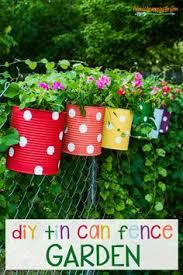 fence garden ideas. tin can fence garden ideas