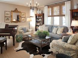 stunning small crystal chandelier with grey couch for elegant living room decor using chic cowhide rug