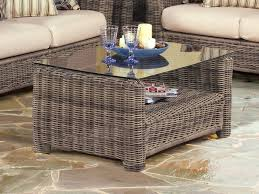 wicker coffee table with glass top design