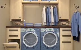 ... Modern small laundry room with wooden cabinets