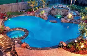 swimming pool lighting options. swimming pool with rock waterfall and lights on at night lighting options r