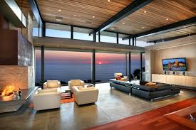 living rooms with great views view modern room panoramic ocean with four white chair sofa and elegant black sofa with floating tv wall and beautiful wooden beautiful open living room