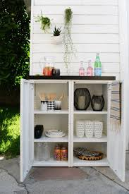 DIY outdoor buffet. 2 IKEA metal cabinets and a custom tiled top create  this modern