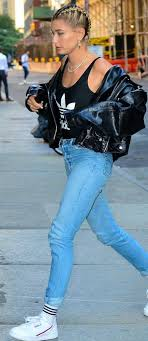 who made hailey baldwin s black top leather jacket jewelry jeans and white sneakers