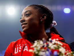 Biles pushes her limits by doing the ...