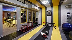 pretty sweet garage gym with yellow stripes and a bar for relaxation on the opposite side garage gym ideas t92