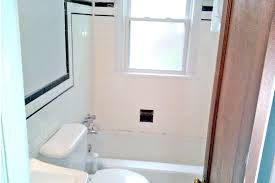 bathroom with tile accents border trim and some other issues that can only be addressed with