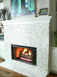 white stacked stone arctic panels fireplace