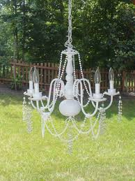 i turned my old shiny brass chandelier into a shabby chic light for my porch