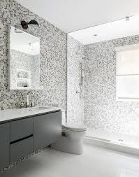 gray kids bathroom features grey hex tiles on the wall and they continue to the