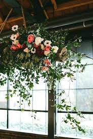 air plant chandelier roses anemones and greenery chandelier for a rustic wedding diy air plant chandelier