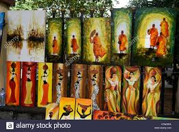 a street art market with paintings produced by local artists on at nelum pouna mawatha