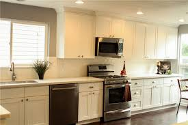 an all white one wall kitchen cabinetry