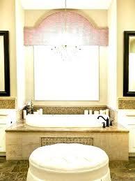 chandelier over tub bathtub mid sized elegant master beige tile and stone marble floor drop in