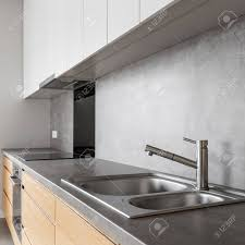 Modern White And Wooden Kitchen Cabinets With Concrete Countertop