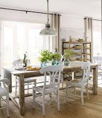 chrome finished pendant lamp with classic white table for modern dining room decor ideas with sisal rug