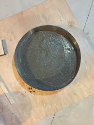 mix the concrete to create the table top