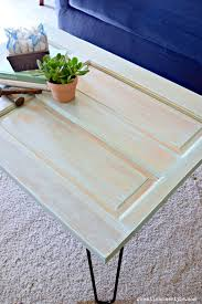 turn an old door into a gorgeous weathered farmhouse style coffee table