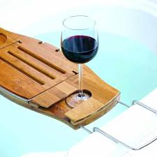 wooden bathtub caddy features soap holder fold over book support wine glass holder bath holder place