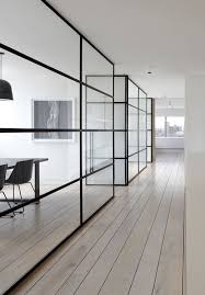 combined office interiors.  Combined Glass Walls With Wide Black Panes For Office Spaces That Want Sound Privacy  But Still Transparent To Combined Office Interiors