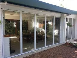 frameless pivot doors aluminium framed stacking