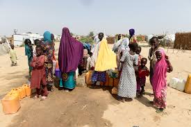 integrated campaign tackles malaria and polio in north  displaced mothers and children fetch water from a borehole at muna idps camp in maiduguri