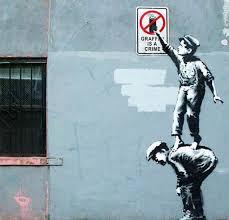 on banksy wall art prints with banksy graffiti is a crime wall art print on wood